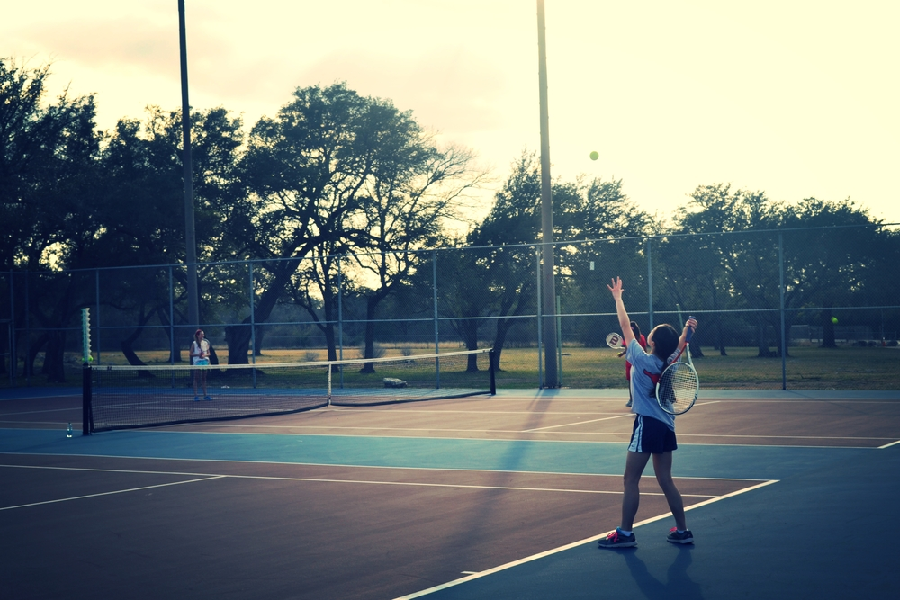 8th grader Amy N. serves to the other team. Photo by Emily
