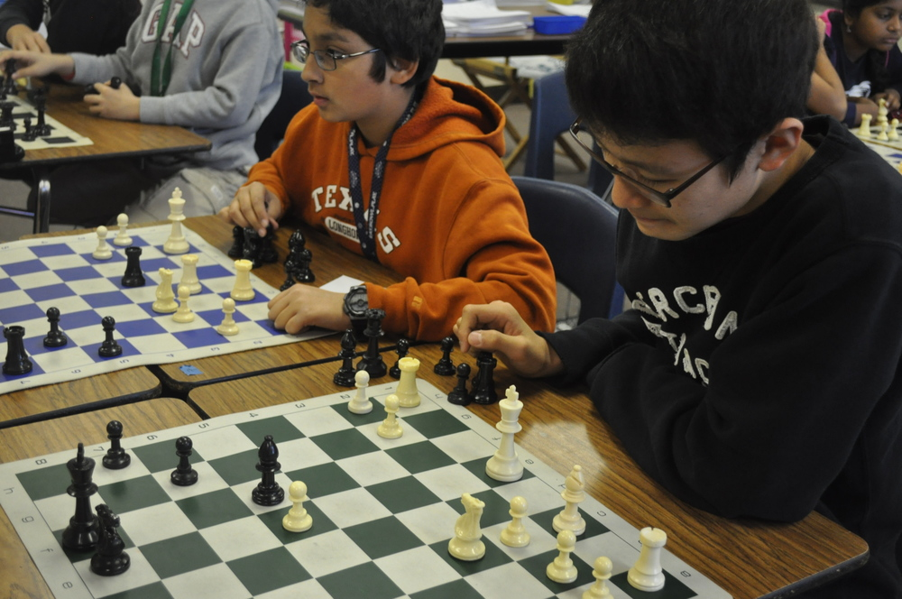 6th grader Aditya D. and 7th grader David K. strategize on their next move at Competitive Chess Club. Photo by Yoonsoo
