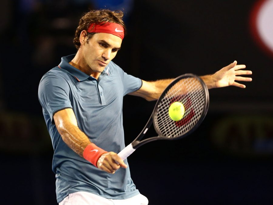 MELBOURNE%2C+AUSTRALIA+-+JANUARY+20%3A++Roger+Federer+of+Switzerland+plays+a+backhand+in+his+fourth+round+match+against+Jo-Wilfried+Tsonga+of+France+during+day+eight+of+the+2014+Australian+Open+at+Melbourne+Park+on+January+20%2C+2014+in+Melbourne%2C+Australia.++%28Photo+by+Matt+King%2FGetty+Images%29