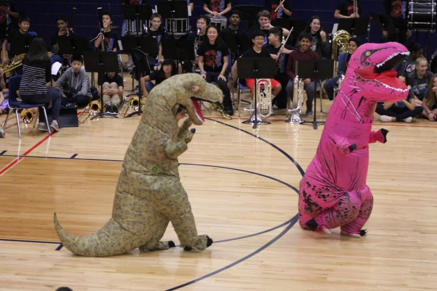 Mrs.+Hagerty+and+Mrs.+Gutierrez+dance+at+the+pep+rally+as+dinosaurs.+