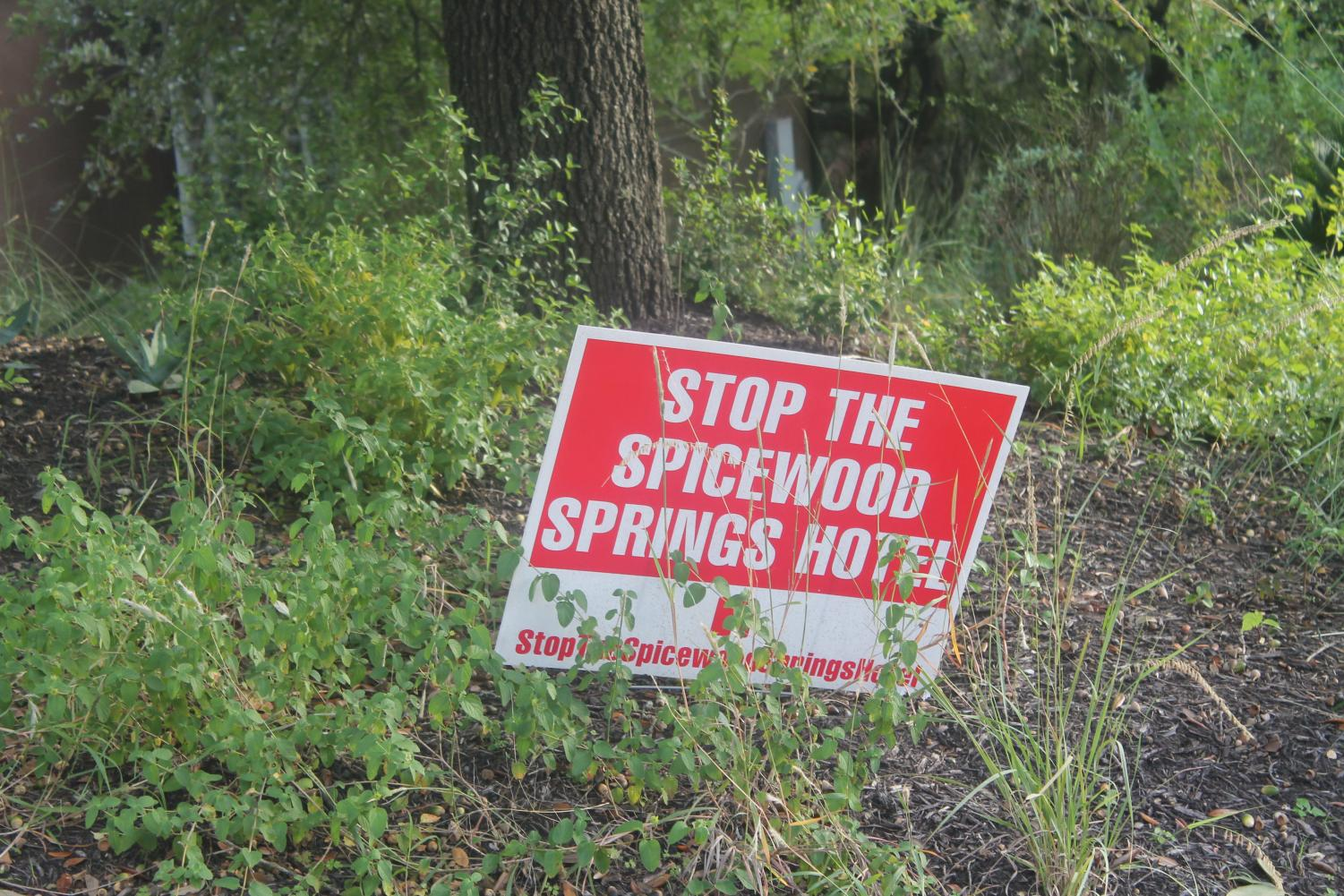 Many people have these red signs in protest of the Spicewood Springs Hotel. You may have seen them last year put up near the school.