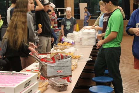 a table was set up and filled with various foods brought by the students