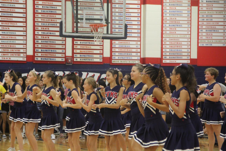 The+cheerleaders+dance+in+unison+