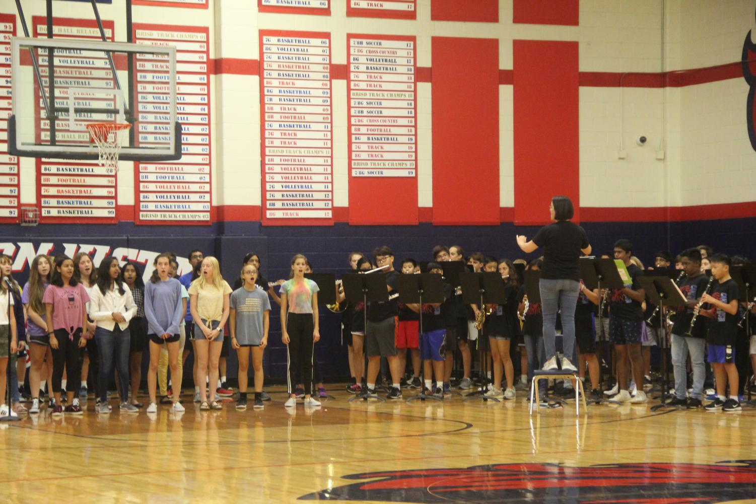 Honor+Choir+leads+the+school+in+our+school+song