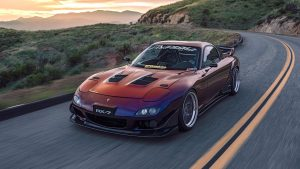 A midnight fade body paint for a mazda rx7 doing a flyby a very pretty car